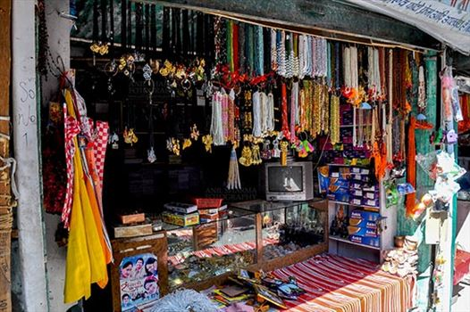 Gangotri, Uttarakhand, India- May 13, 2015: Shops of necklaces, beads, jewelry, gemstones, bracelets, earrings, bangles and devotional objects for religious ceremonies at Gangotri, Uttarkashi, Uttarakhand, India.