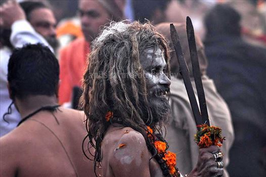 Culture- Aghori Sadhu, Uttar Pradesh (India). - Smile of an old Aghori baba with long hairs, ash on face at Mahakumbh Prayag, Allahabad, Uttar Pradesh (India).