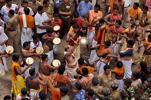 Devotees singing and dancing on the occasion of Rath Yatra at Puri, Odisha, India.