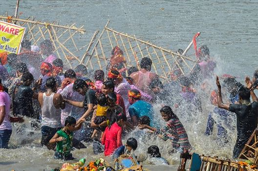 Durga Puja Festival, New Delhi, India-September 30, 2017: Hindu devotees taking holy dip after immersing Goddess Durga idol into river Yamuna at Kalindi Kunj, New Delhi, India.