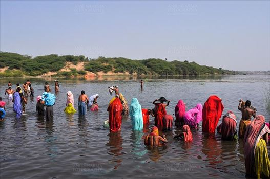 Baneshwar, Dungarpur, Rajasthan, India- February 14, 2011: Devotees ready for the traditional ritual bath at the confluence of the rivers, Mahi and Som at Baneshwar, Dungarpur, Rajasthan, India