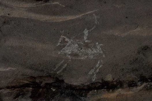 Archaeology- Bhimbetka Rock Shelters (India) - Prehistoric Rock Painting of a men riding a horse in white color at Bhimbetka archaeological site, Raisen, Madhya Pradesh, India