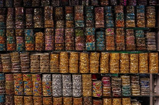 Religion- Dargah Sharif, Ajmer, Rajasthan (India) - Colourful bangles shop at shine market place of Ajmer Sharif Dargah the Mausoleum of Moinuddin Chishti, a sufi saint from India at Ajmer, Rajasthan, India.