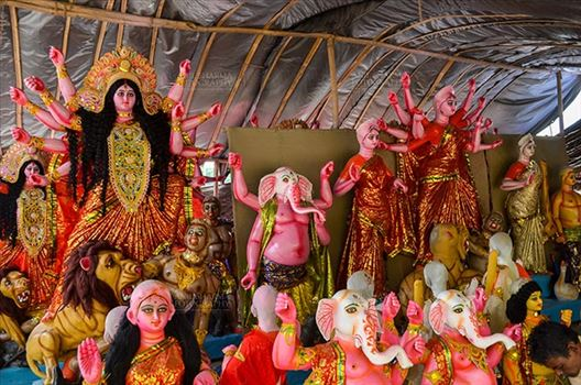 Durga Puja Festival, Noida, Uttar Pradesh, India- September 20, 2017: A row of Hindu God Lord Ganesha and Goddess Durga in a workshop at Noida, Uttar Pradesh, India.
