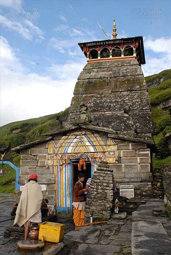 Tungnath, Chopta, Uttarakhand, India- August 18, 2009: Prist and devotees at the Main Tungnath temple complex at Tungnath, Chpota, Uttarakhand, India.