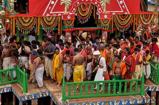 The religious custom of Gajpati king wearing the outfit of a sweeper and sweeping the chariot before the commencement of the rath yatra, for Jagannath Rath Yatra festival at Puri, Odisha, India.