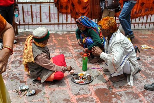 Gangotri, Uttarakhand, India- June 14, 2013: A Hindu family making a religious ritual at Goddess Ganga Temple, Gangotri, Uttarakhand, India.