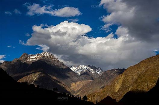 Clouds- Sky with Clouds (Jispa Village) - Clouds, Jispa, Himachal Pradesh, India- September 24, 2014: Dark blue sky with white clouds floating over the snow covered mountain peaks at Jispa Village, Lahaul-Spiti, Himachal Pradesh, India.