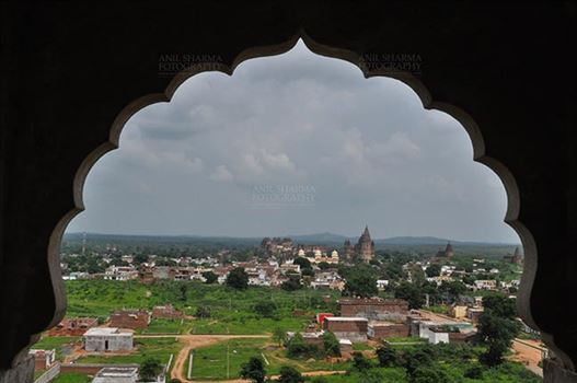 Orchha, Madhya Pradesh, India- August 20, 2012: View from a carved window of Laxmi Temple, Chaturbhuj temple is seen in the distance, Orchha, Madhya Pradesh, India.
