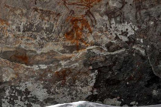 Archaeology- Bhimbetka Rock Shelters (India) - Prehistoric Rock Painting- a Hunter aiming at a deer at Bhimbetka archaeological site, Raisen, Madhya Pradesh, India