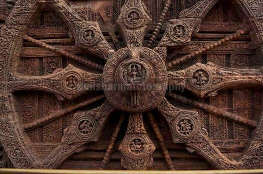 One of the highly ornate carved wheels of Sun temple at Konark, Orissa, India.