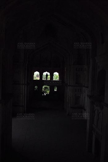 Orchha, Madhya Pradesh, India- August 20, 2012: Silhouette of a woman in Chaturbhuj Temple at Orchha, Madhya Pradesh, India.