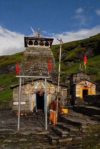 Tungnath, Chopta, Uttarakhand, India- August 18, 2009: Hanging bells and red color flags at Tungnath temple complex at Tungnath, Chpota, Uttarakhand, India.