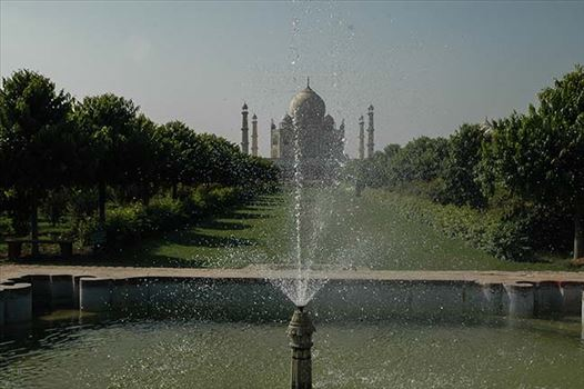 Monuments- Taj Mahal, Agra (India) - Fountain at Taj Mahal complex with Taj Mahal in the background at Agra, Uttar Pradesh, India.
