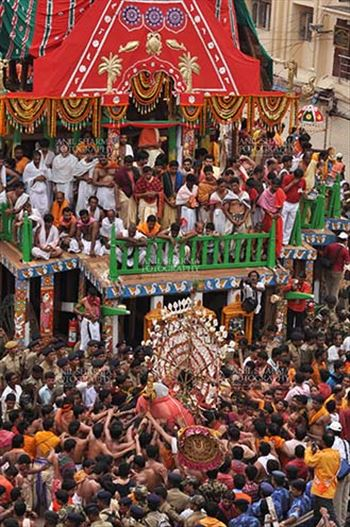 Festivals- Jagannath Rath Yatra (Odisha) - Deity of Balbhadra being taken to the chariot on the occasion of Rath Yatra at Puri, Odisha, India.