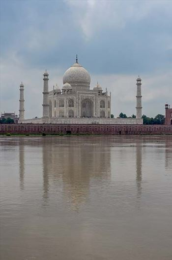 Monuments- Taj Mahal, Agra (India) - The Beauty of Taj Mahal in rainy season with flooded river Yamuna water all arround at Agra, Uttar Pradesh, India.