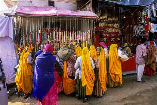 Pushkar, Rajasthan, India- May 23, 2008: Devotees buying Bangels from a shop at Pushkar fair, Rajasthan, India.
