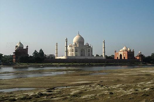 Monuments- Taj Mahal, Agra (India) - The beauty of Taj Mahal (back side view) with blue sky and river yamuna flowing at Agra, Uttar Pradesh, India