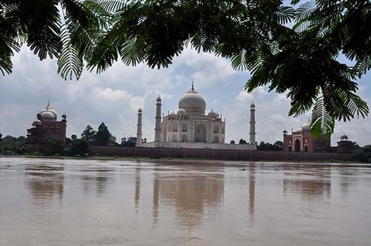 Monuments- Taj Mahal, Agra (India) - Taj Mahal in rainy season with flooded river Yamuna water all arround at Agra, Uttar Pradesh, India.