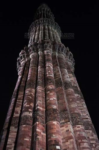 Qutab Minar with Architecure details and verses from Holy Quran at Qutab Minar Complex, New Delhi, India.