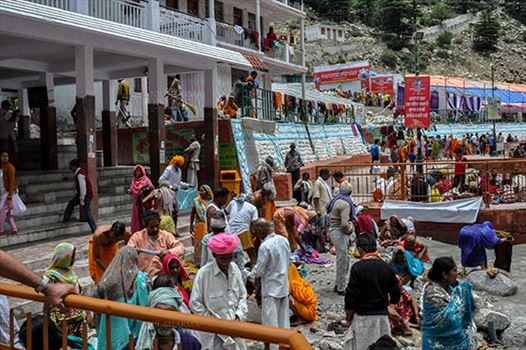 Gangotri, Uttarakhand, India- June 14, 2013:  Devotees at Goddess Ganges Temple to perform prayer ritual and to have holy dip into Bhagirathi River at Gangotri, Uttarkashi, Uttarakhand, India.