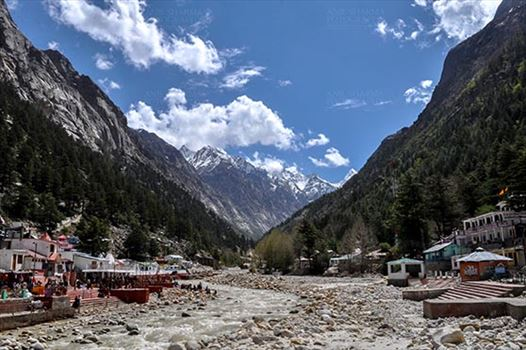 Gangotri, Uttarakhand, India- May 13, 2015: Snow covered Himalayan peaks, blue sky and Goddess Ganges Temple at the bank of Holy River Bhagirathi, Gangotri, Uttarakhand, India.