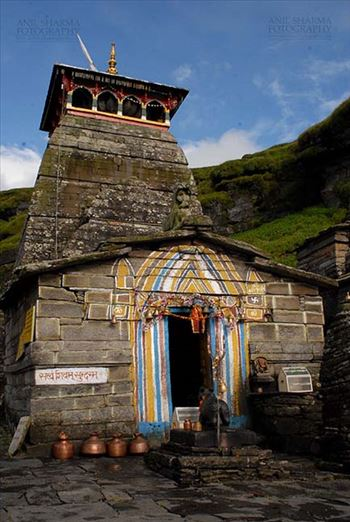 Tungnath, Chopta, Uttarakhand, India- August 18, 2009: Main Tungnath temple complex with Hanging bells on the door at Tungnath, Chpota, Uttarakhand, India.