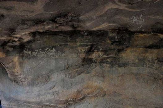 Archaeology- Bhimbetka Rock Shelters (India) - Prehistoric Rock Painting showing hunters riding horses in white color at Bhimbetka archaeological site, Raisen, Madhya Pradesh, India