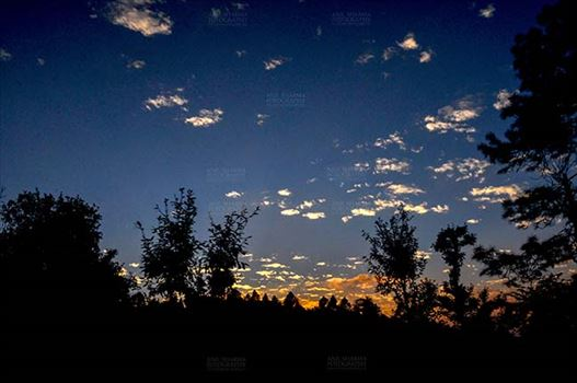 Clouds- Sky with Clouds (Almora) - Clouds, Almora, Uttarakhand, India- November 4, 2016: After sunset, dark blue sky with small pathces of white clouds in the evening at Almora, Uttarakhand, India