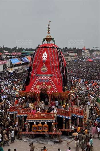 Massive chariot of Lord Balbhadra surrounded by thousands of enthused pilgrims, for Jagannath Rath Yatra festival at Puri, Odisha, India.