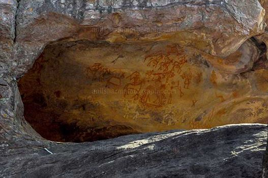 Archaeology- Bhimbetka Rock Shelters (India) - Prehistoric rock painting showing chief of warrior's leading his team at Bhimbetka archaeological site, Raisen, Madhya Pradesh, India